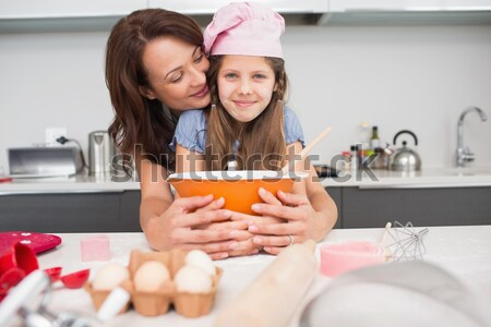 Mother and daughter using a rolling pin together in the kitchen Stock photo © wavebreak_media