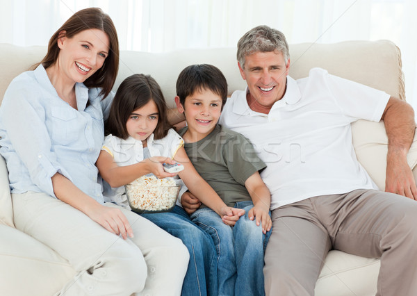 Family watching tv while they are eating popcorn Stock photo © wavebreak_media