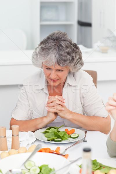 Woman praying at the table Stock photo © wavebreak_media