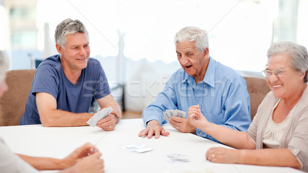 Retired people playing cards together at home Stock photo © wavebreak_media