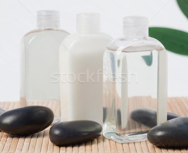 Stok fotoğraf: Siyah · taşlar · masaj · yağı · şişeler · duvar · arka · plan