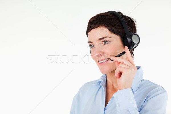 Close up of a office worker using a headset against a white background Stock photo © wavebreak_media