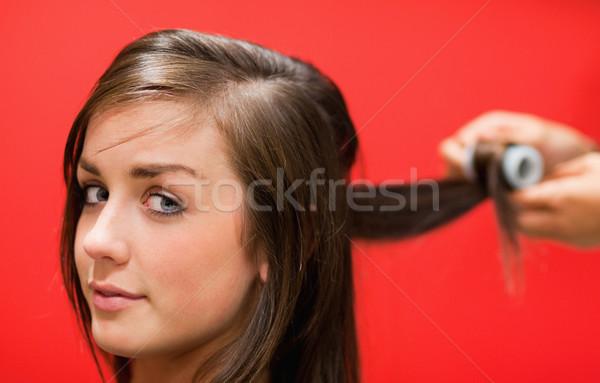 Woman having her hair rolled with a curler Stock photo © wavebreak_media