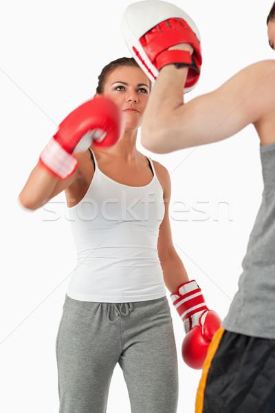 Fiatal női gyakorol küzdősportok fehér sport Stock fotó © wavebreak_media