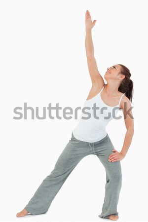 Portrait of a woman in the Utthita Trikonasana position against a white background Stock photo © wavebreak_media