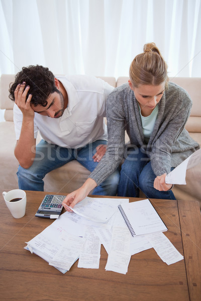 Portrait of a depressed couple doing their accounting in their living room Stock photo © wavebreak_media