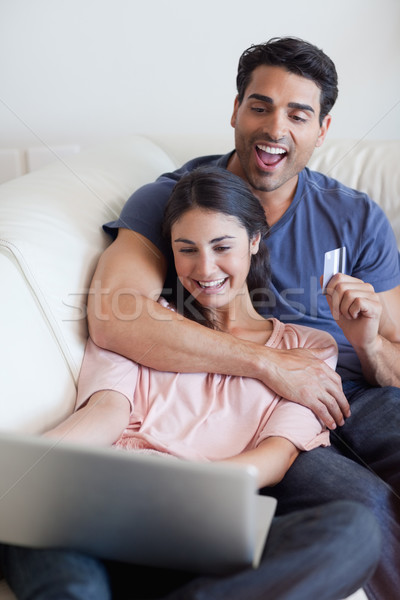 Portrait of a happy couple booking their holidays online in their living room Stock photo © wavebreak_media
