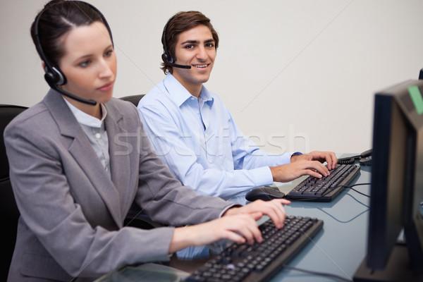 Yandan görünüş genç call center çalışma ofis bilgisayar Stok fotoğraf © wavebreak_media