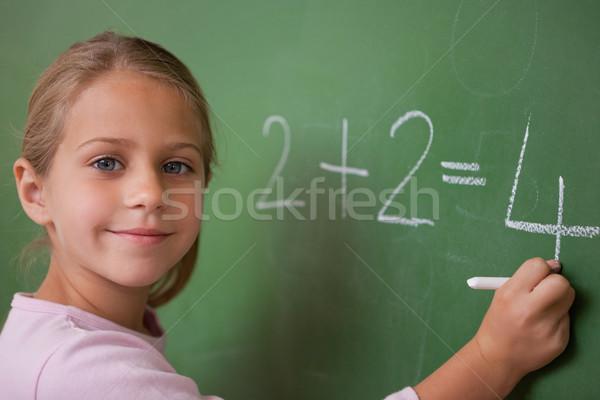 Lächelnd Schülerin schriftlich Zahl Tafel Schule Stock foto © wavebreak_media