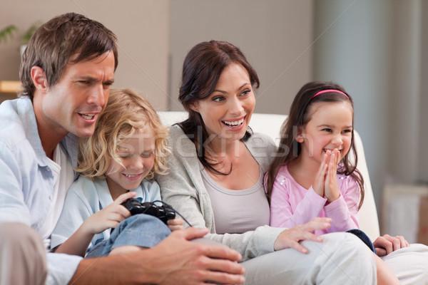 Mutlu aile oynama video oyunları birlikte oturma odası aile Stok fotoğraf © wavebreak_media