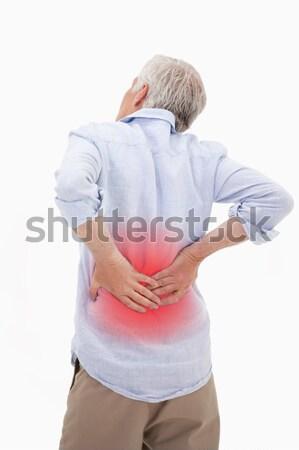 Portrait of a man having a back pain against a white background Stock photo © wavebreak_media