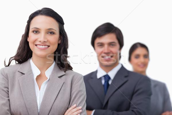 Glimlachend permanente armen gevouwen witte Stockfoto © wavebreak_media