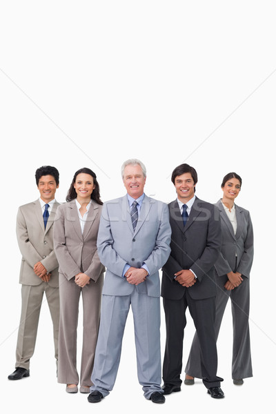 Smiling mature salesman standing together with his team against a white background Stock photo © wavebreak_media