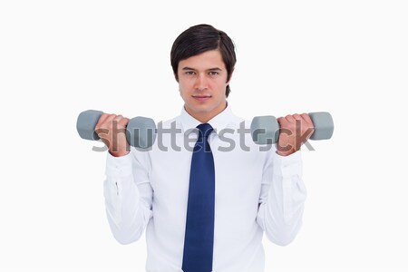 Tradesman lifting weights against a white background Stock photo © wavebreak_media