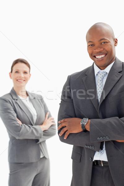 улыбаясь бизнесмен женщину рук сложенный заседание Сток-фото © wavebreak_media