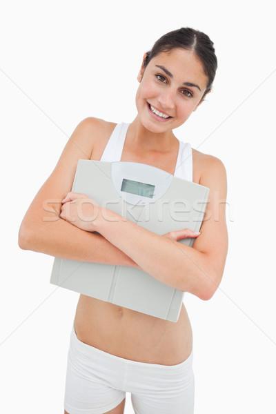 Glimlachend jonge vrouw schalen witte gelukkig Stockfoto © wavebreak_media