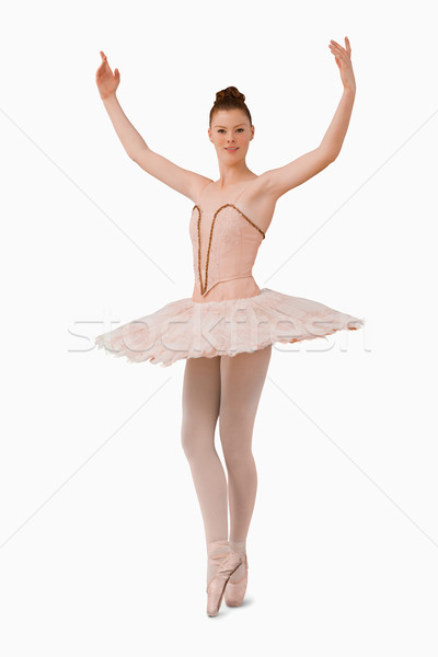 Ballerina with her arms risen against a white background Stock photo © wavebreak_media