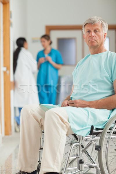 Beteg tolószék néz kamera kórház folyosó Stock fotó © wavebreak_media