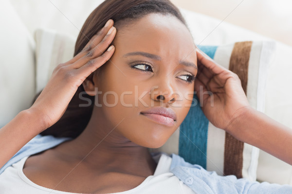 Black woman having pains on the head in a living room Stock photo © wavebreak_media