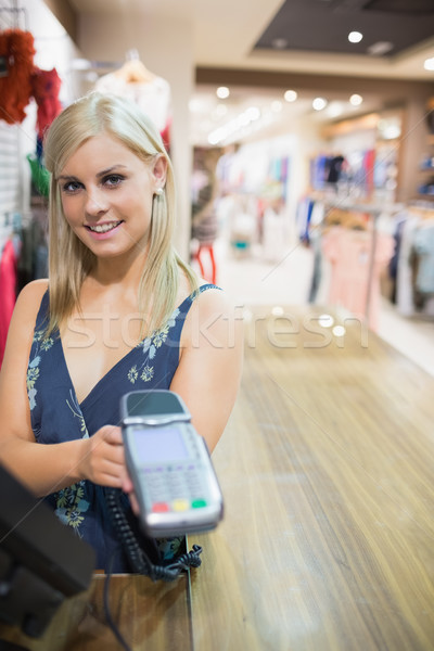 Woman showing credit card machine in clothes store Stock photo © wavebreak_media