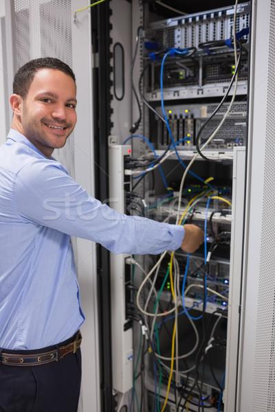 улыбаясь человека сервер центр обработки данных компьютер улыбка Сток-фото © wavebreak_media