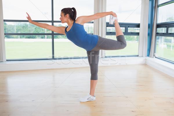 Woman doing yoga pose in fitness studio Stock photo © wavebreak_media