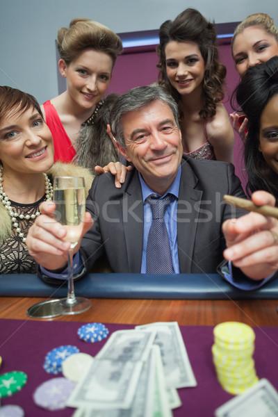 Women surrounding man at roulette table in casino Stock photo © wavebreak_media