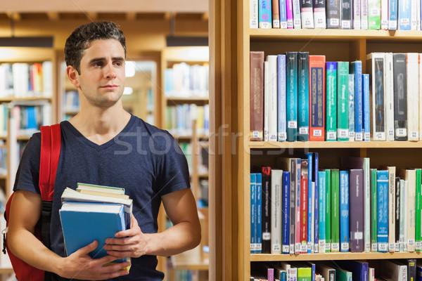 öğrenci ayakta kütüphane kitaplar Stok fotoğraf © wavebreak_media