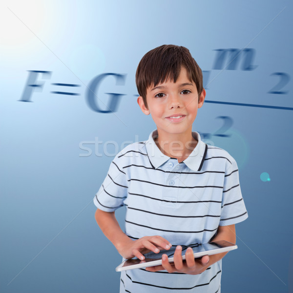 Male pupil with tablet pc on background with maths formula Stock photo © wavebreak_media