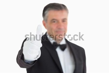 Pleased waiter having thumbs up in front of camera Stock photo © wavebreak_media
