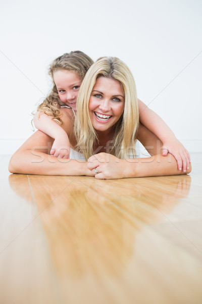 Laughing mother and daughter resting on the floor  Stock photo © wavebreak_media