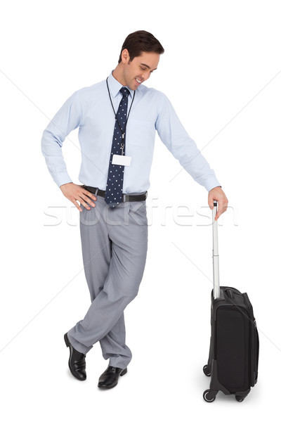 Businessman looking at his suitcase and smiling Stock photo © wavebreak_media