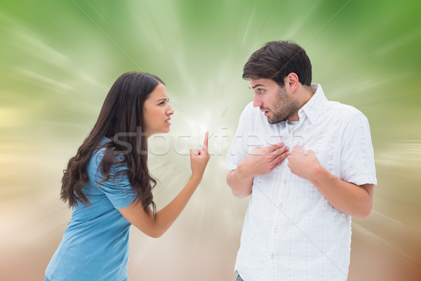 Composite image of angry brunette shouting at boyfriend Stock photo © wavebreak_media