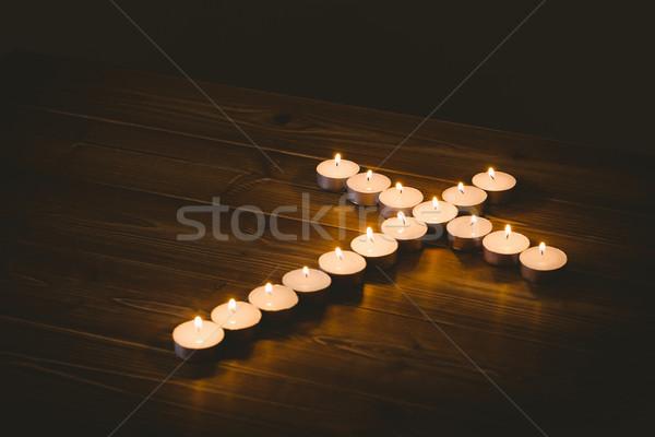 Candles in shape of cross Stock photo © wavebreak_media