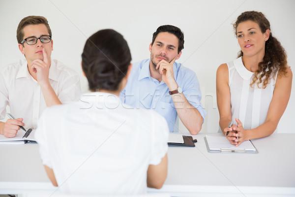 Woman being interviewed by business people Stock photo © wavebreak_media