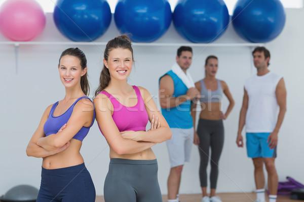 Fit women in sports bra with friends in background Stock photo © wavebreak_media