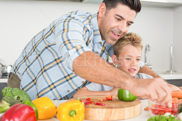 Handsome father showing his son how to prepare vegetables Stock photo © wavebreak_media