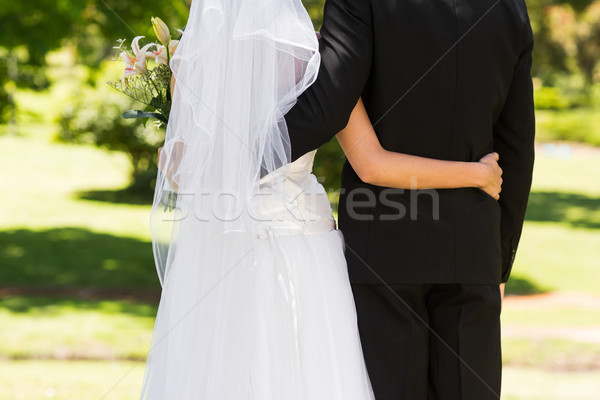 Mid section of a newlywed with arms around in park Stock photo © wavebreak_media
