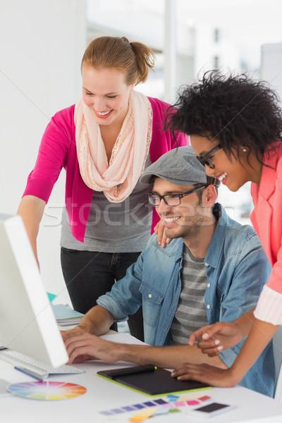 Mosolyog dolgozik számítógép iroda oldalnézet három Stock fotó © wavebreak_media
