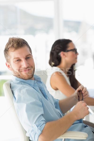 Feliz estilista sorridente câmera secretária criador Foto stock © wavebreak_media