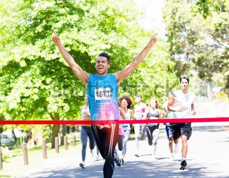Maraton futó célszalag fiatal karok a magasban sport Stock fotó © wavebreak_media