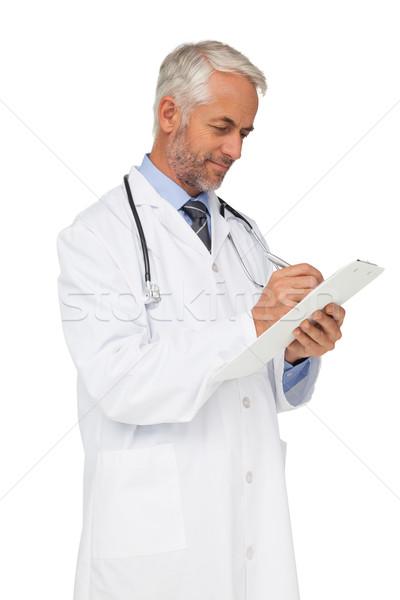 Concentrado doctor de sexo masculino escrito informes blanco médico Foto stock © wavebreak_media