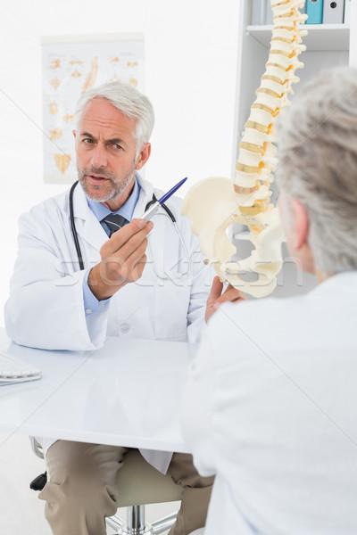 Férfi orvos magyaráz gerincoszlop idős beteg asztal Stock fotó © wavebreak_media