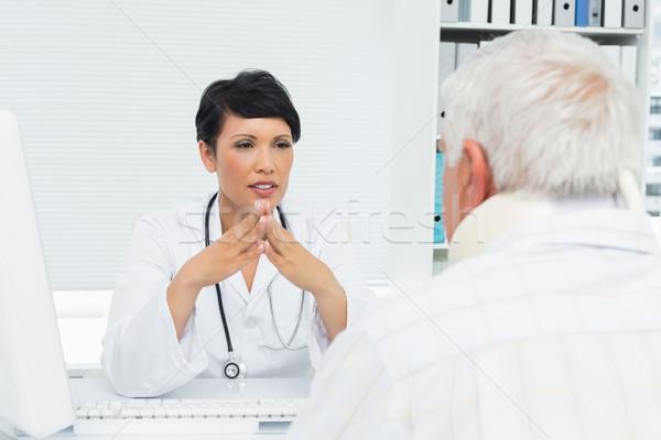 Female doctor attentively listening to senior patient Stock photo © wavebreak_media
