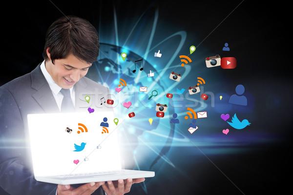 üzletember mutat laptop app ikonok digitális kompozit Stock fotó © wavebreak_media