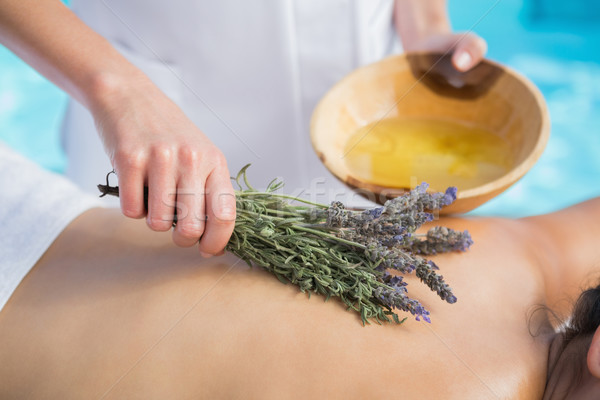 Woman getting an aromatherapy treatment poolside Stock photo © wavebreak_media