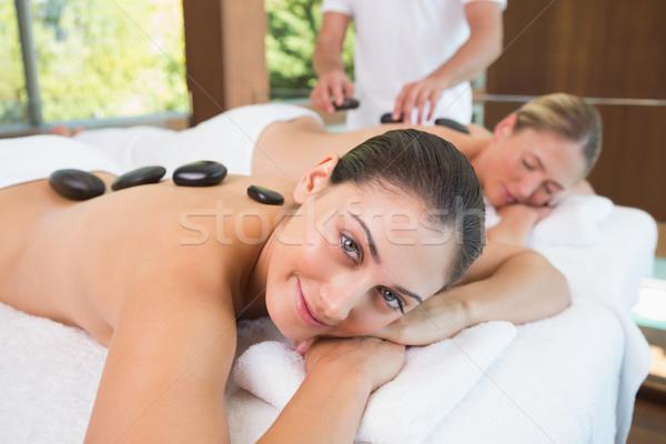 Bella amici massaggio caldo pietre Foto d'archivio © wavebreak_media