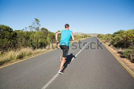Athletic man jogging on open road Stock photo © wavebreak_media