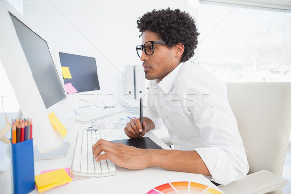 Hipster designer working at his desk Stock photo © wavebreak_media