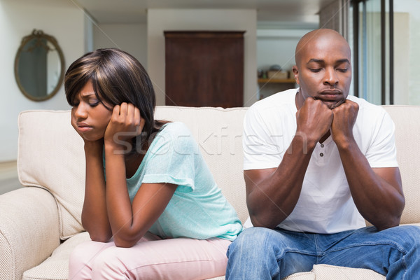 Infeliz casal argumento sofá casa sala de estar Foto stock © wavebreak_media
